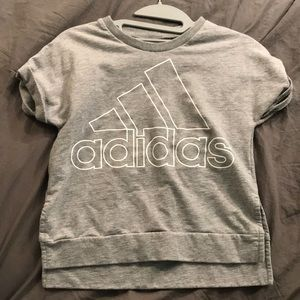 A grey Adidas boxy tee with the logo on the front.